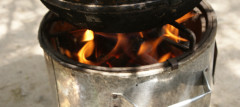 While cooking using firewood, this burner produces charcoal - Photo by Isaiah Esipisu